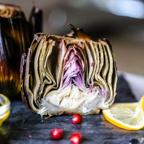 sliced roasted artichoke with lemon