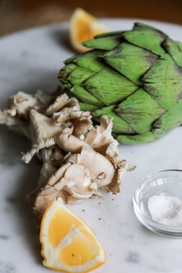 Uncooked artichoke with lemon salt and mushroom