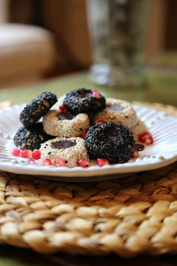 Vegan Tahini Cookies on a plate with pomegranate seeds