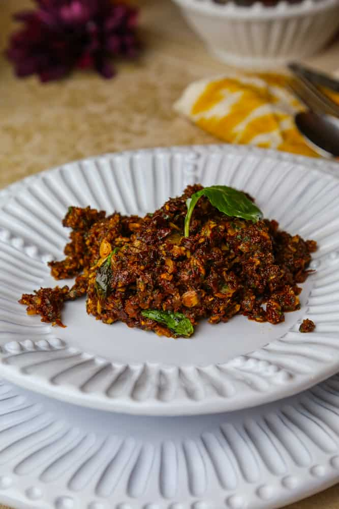 sun dried tomato tapenade with almonds and mint on a plate