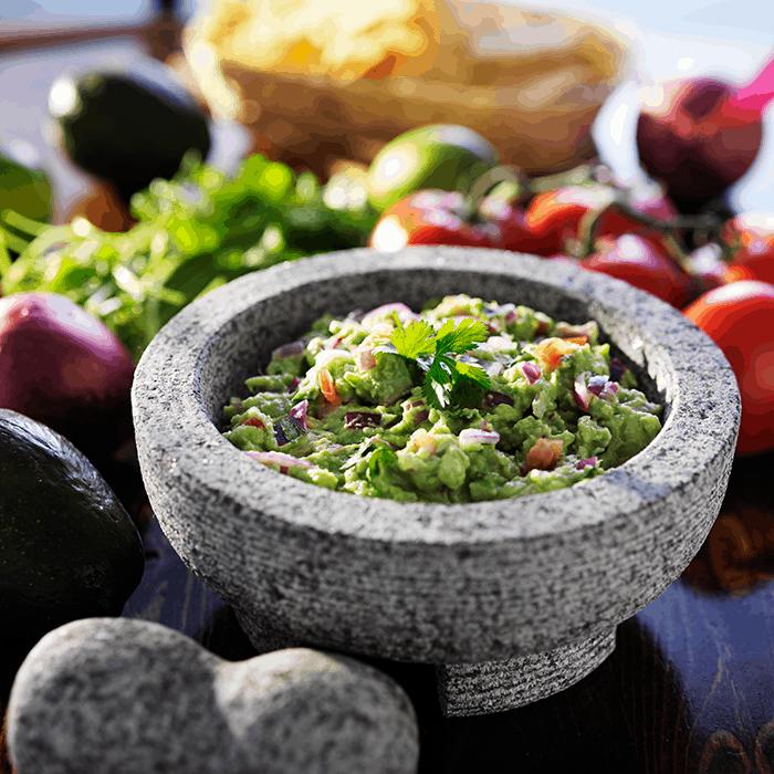guacamole in a mortar and pestle