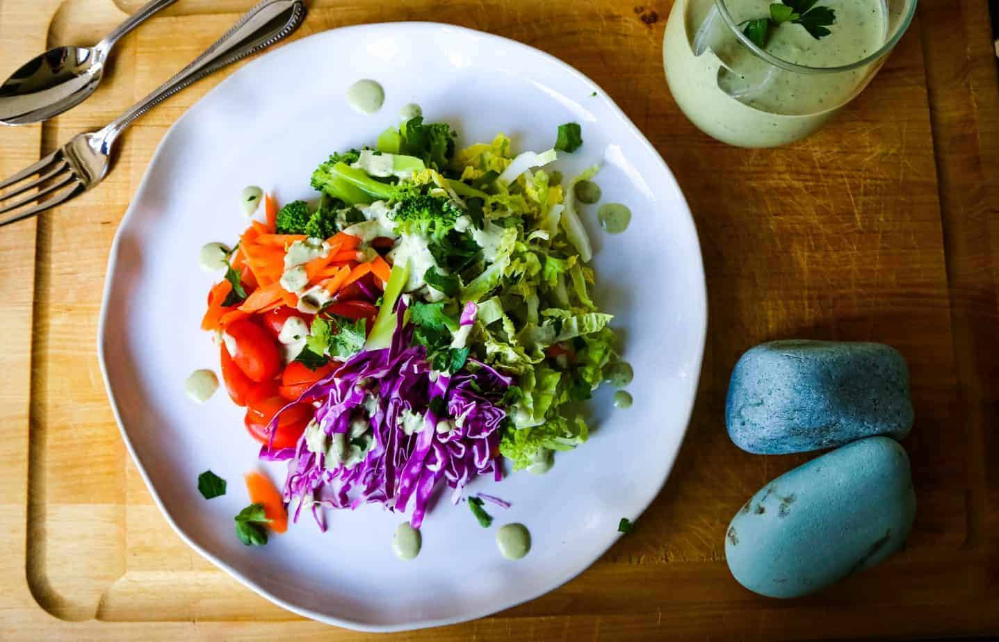 rainbow salad and green goddess dressing on a plate