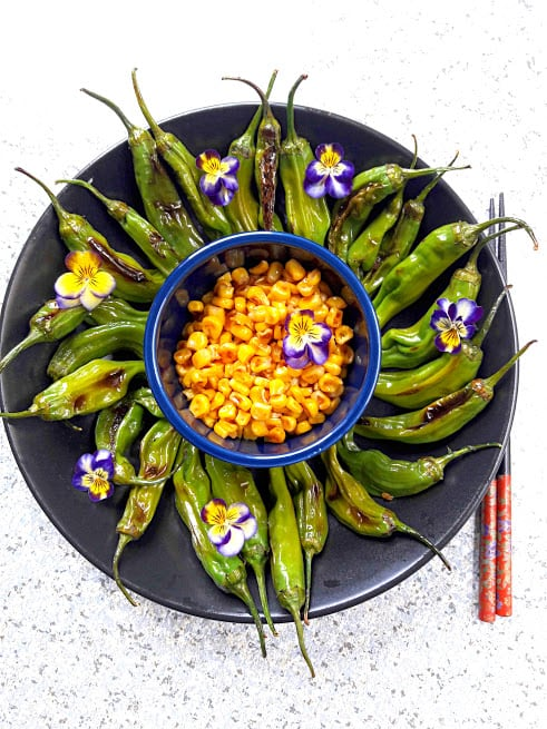 bowl of grilled shishito peppers from above