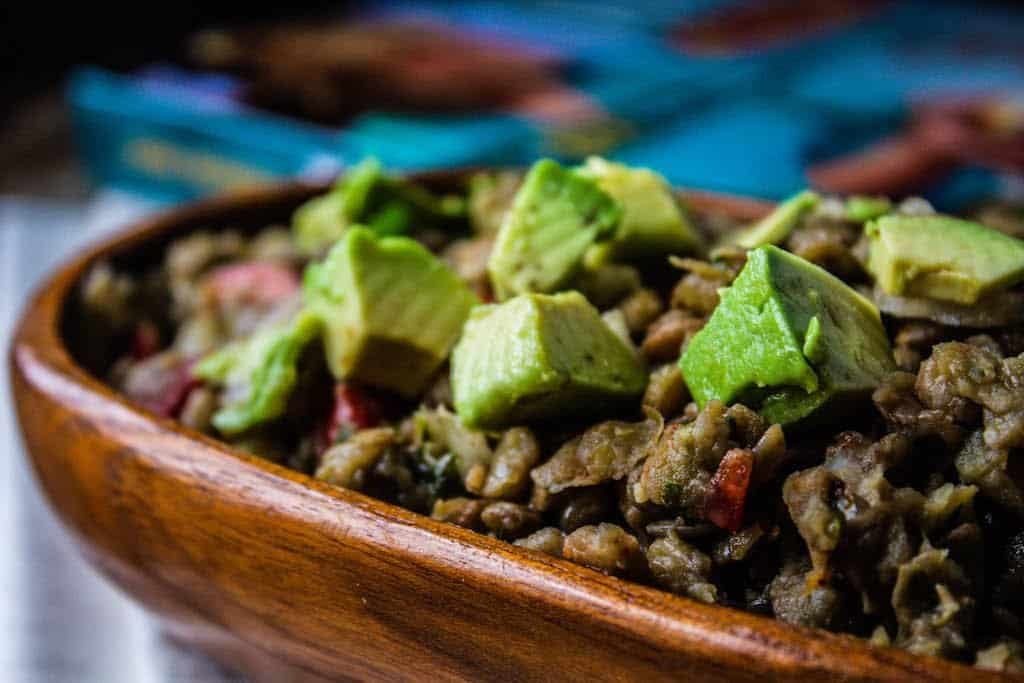 bowl of lentil salad with avocado