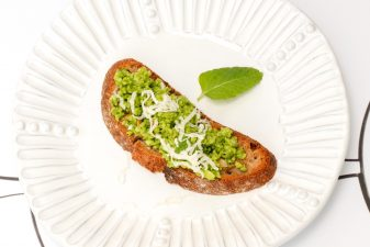 vegan pea pesto and mint crostini on a plate