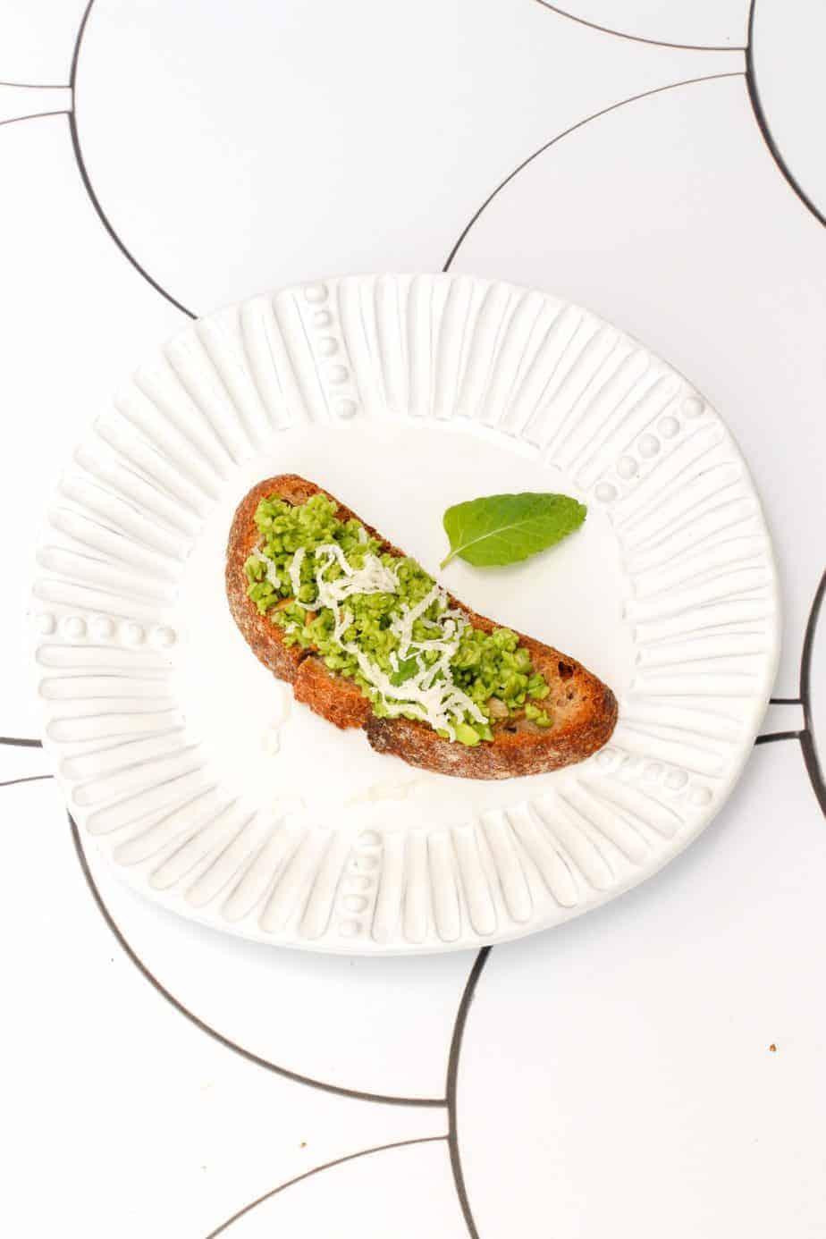 vegan pea pesto and mint crostini on a plate