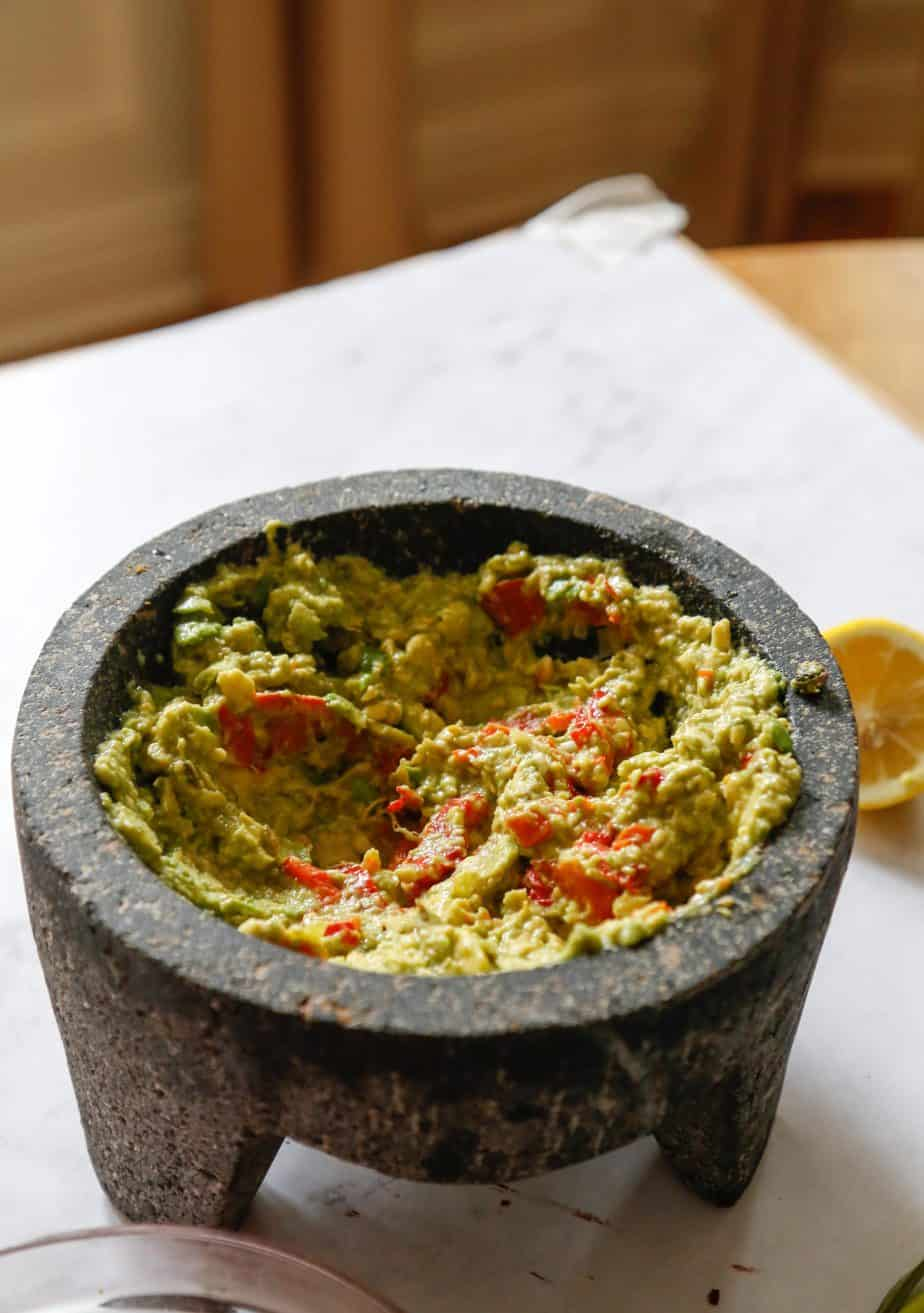Healthy guacamole in a mortar and pestle