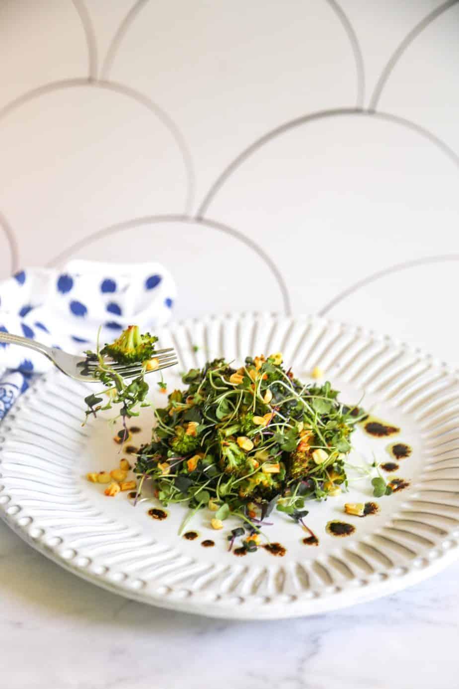 roasted broccoli salad with corn mixed microgreens and balsamic vinaigrette