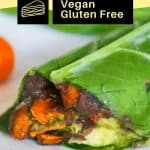 healthy Mexican collard green wrap with sweet potatoes onions and spicy green tahini sauce