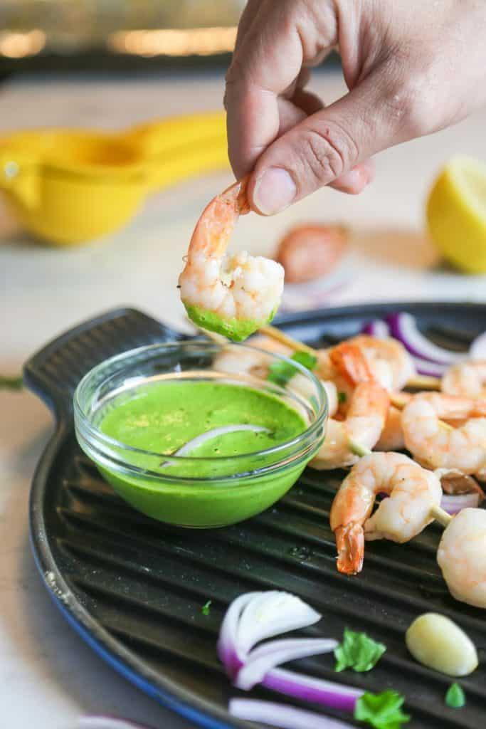 oven baked shrimp kabobs with Vegan Aji Verde Sauce made with garlic tahini lemon juice cilantro parsley shrimp