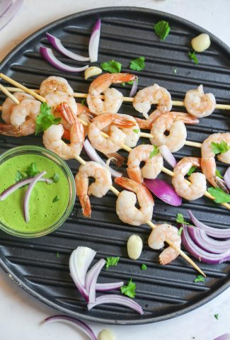 oven roasted shrimp kabobs with vegan Aji Verde sauce from above on a grill pan