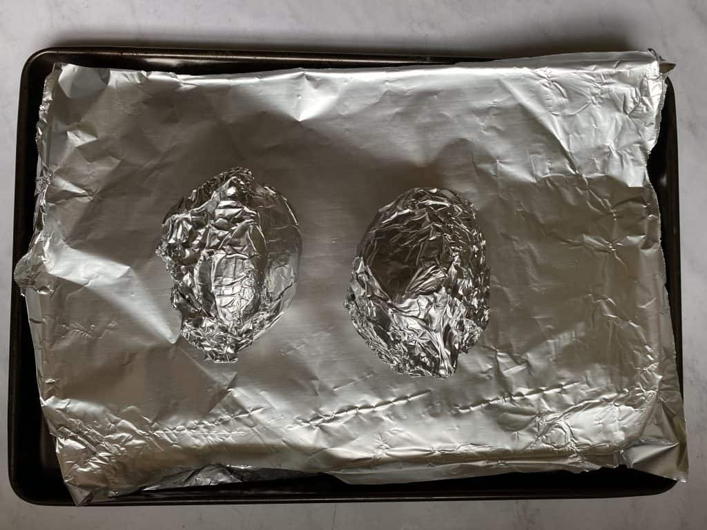 vegan stuffed sweet potato prep photo of sweet potatoes wrapped In foil