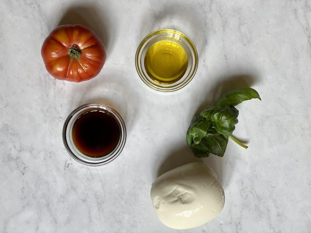 ingredients for Caprese Salad Keto tomatoes olive oil balsamic mozzarella and basil