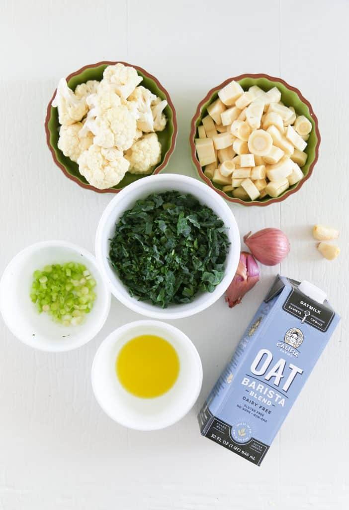 ingredients for parsnip mash. Cauliflower, parsnips, kale, shallots, scallions, garlic, oat milk and olive oil.