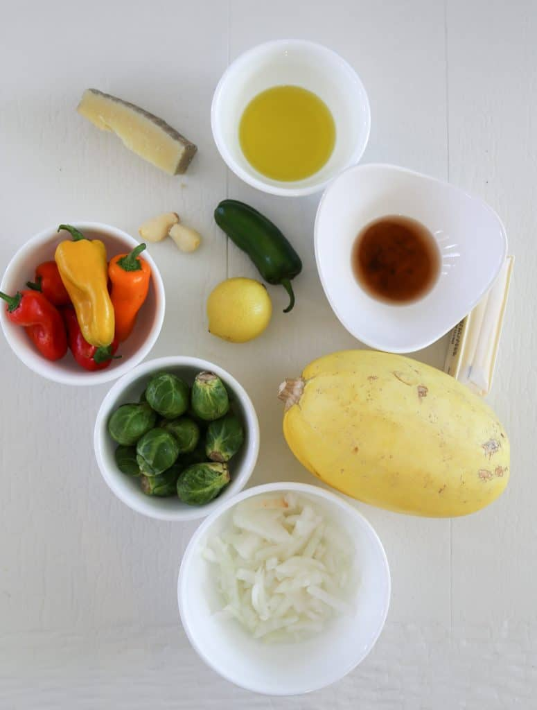 ingredients for vegetarian stuffed spaghetti squash, cheese, olive oil, lemon, peppers, butter, vinegar, spaghetti squash, Brussels sprouts, onions