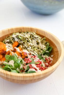 brussels sprouts salad vegan in a bowl with dressing